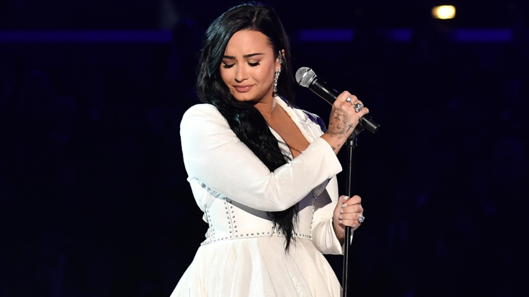 demi lovato on stage with microphone