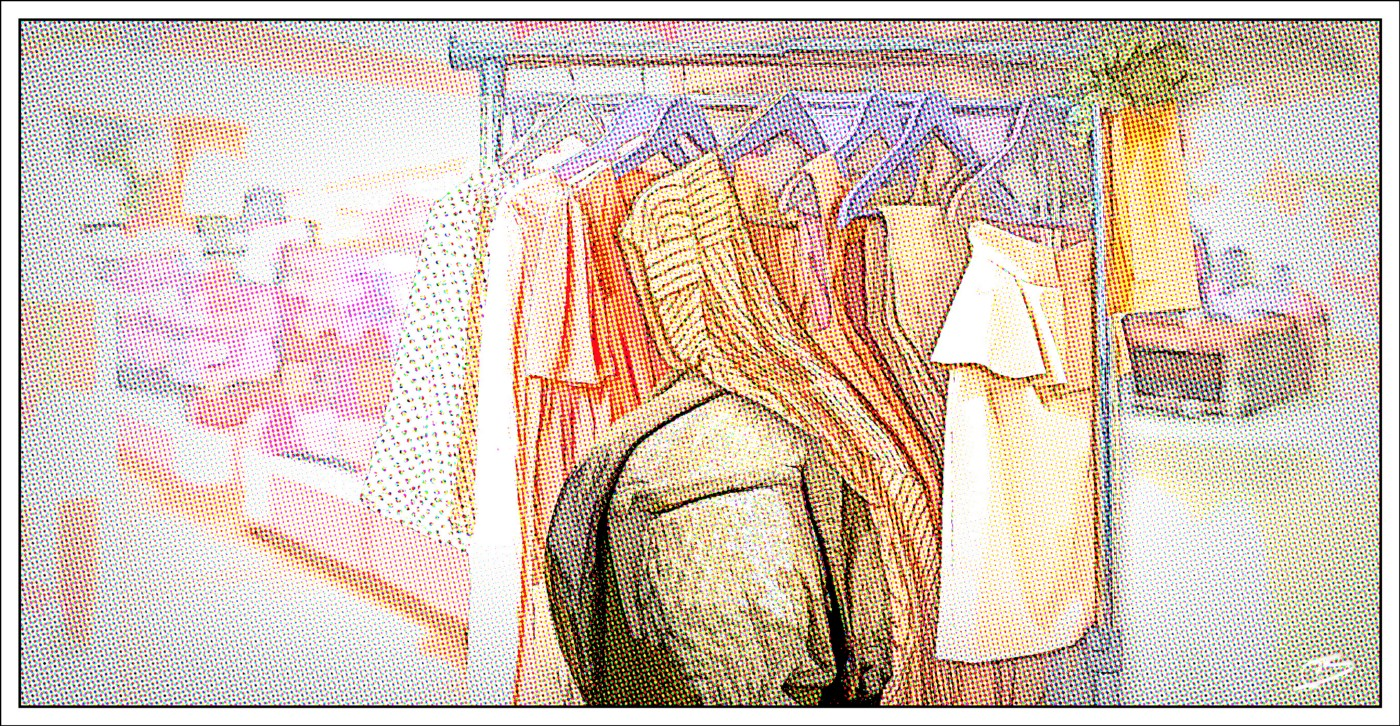rhinoceros pawing through dress rack