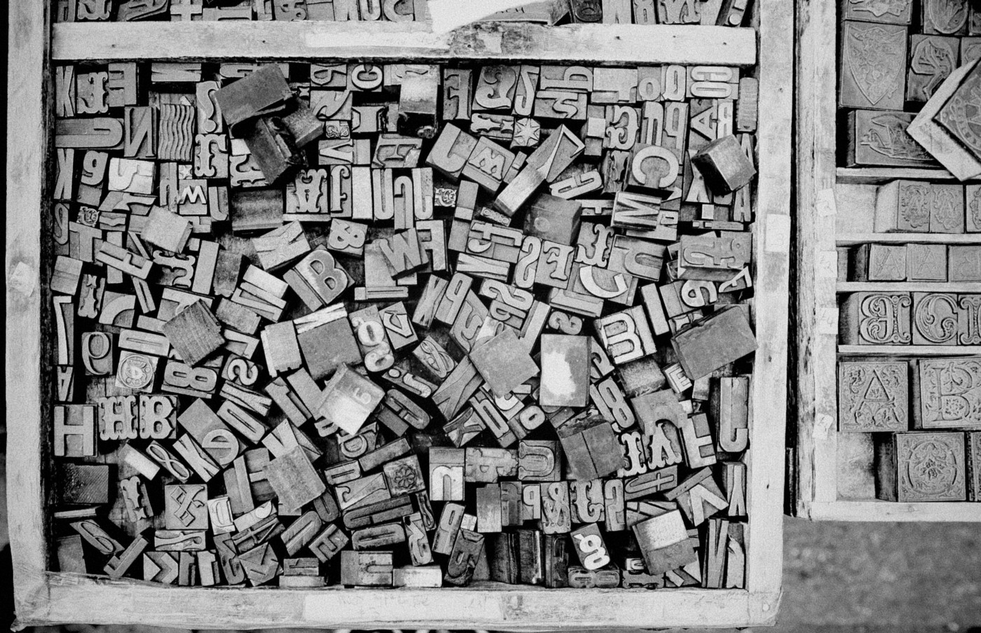 A box of timber type letters. The fundamental form of words from which there is so much possibility.
