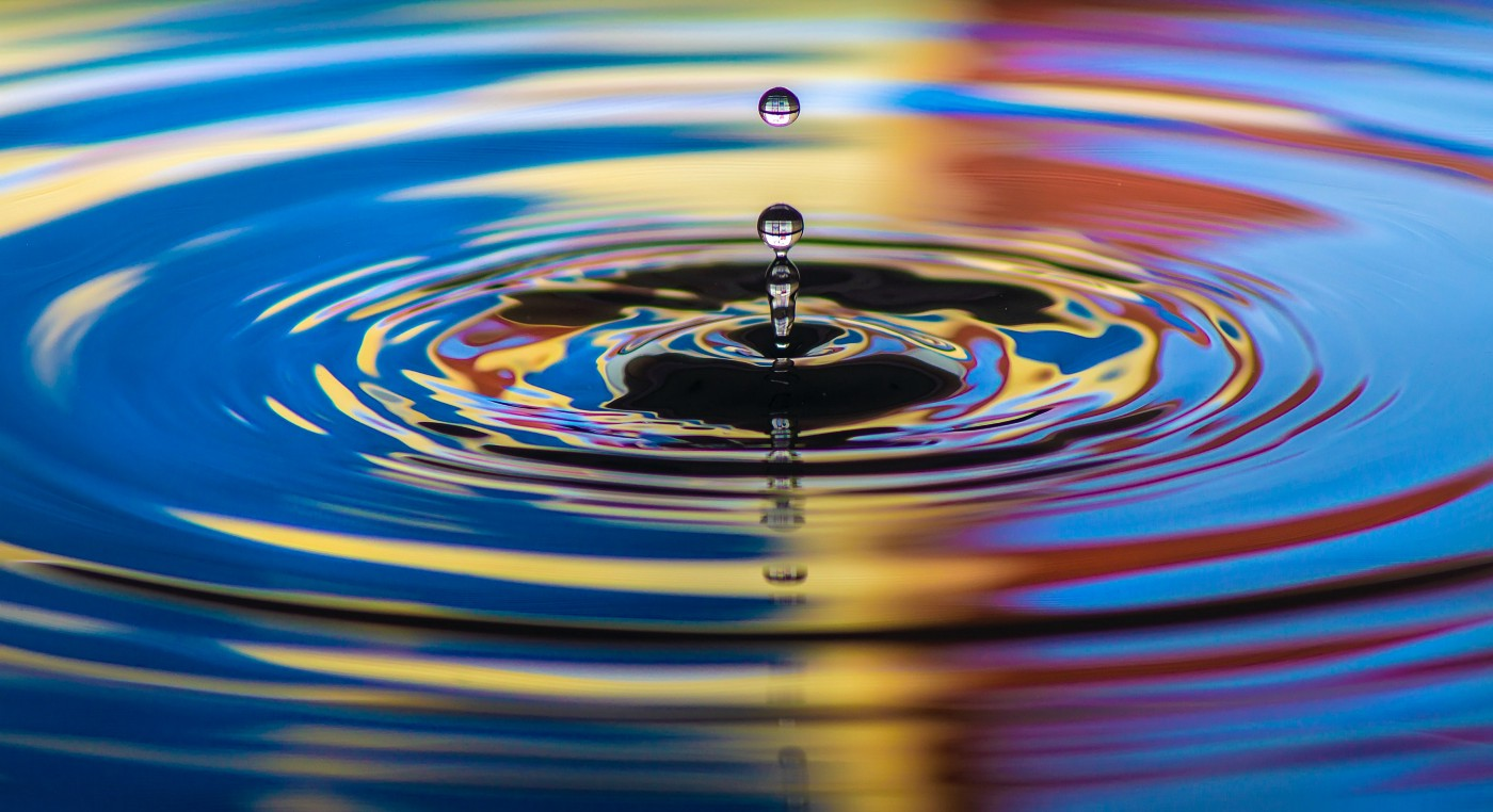 A splash causing a ripple in water.