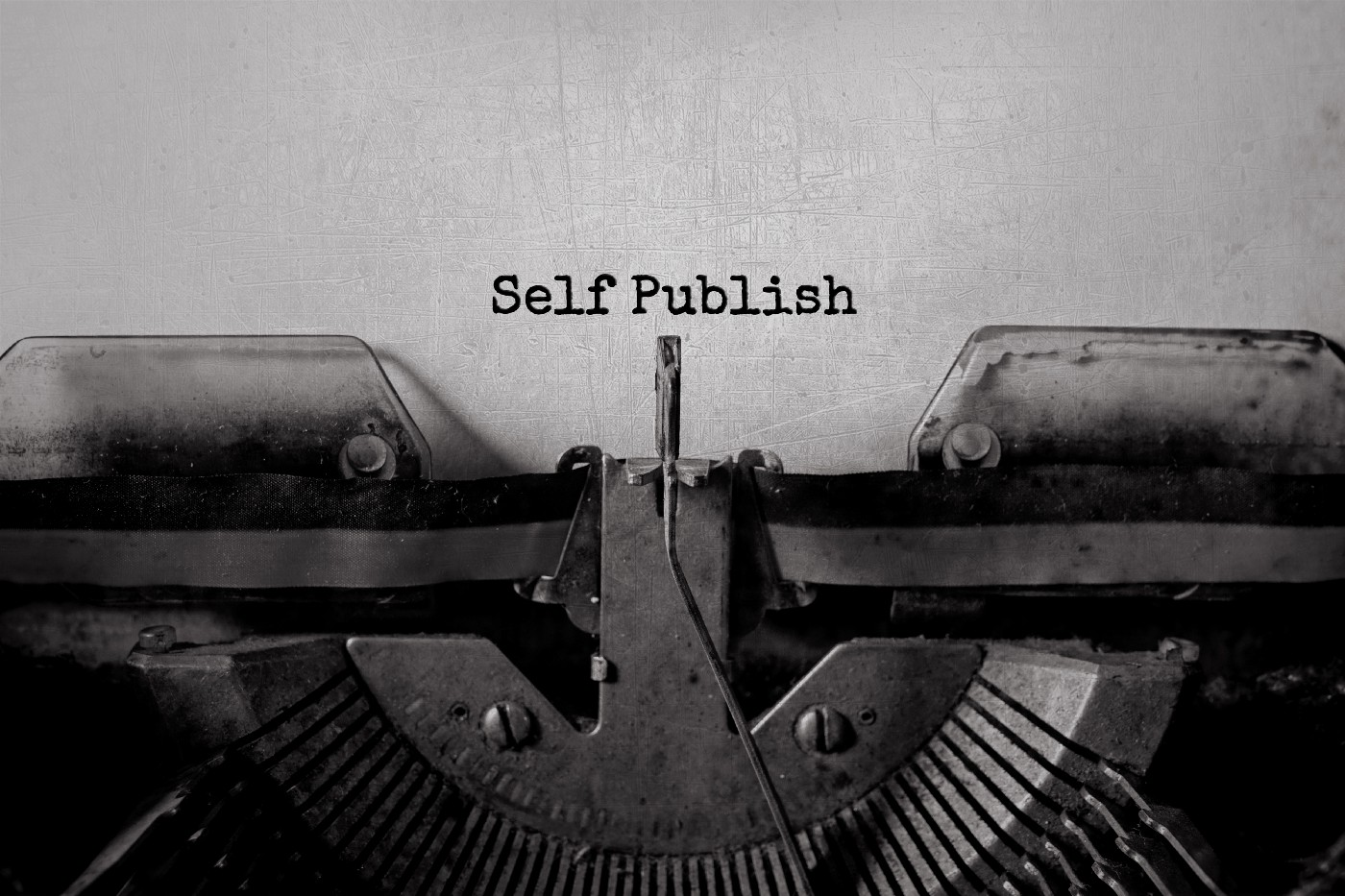 """close up of a typewriter showing the words, """"Self Publish."""""""