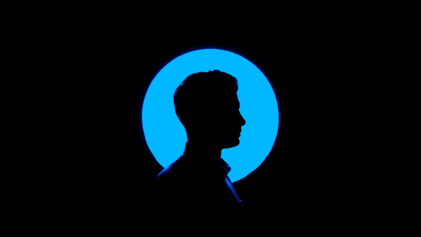 black silhouette of a man against a blue background