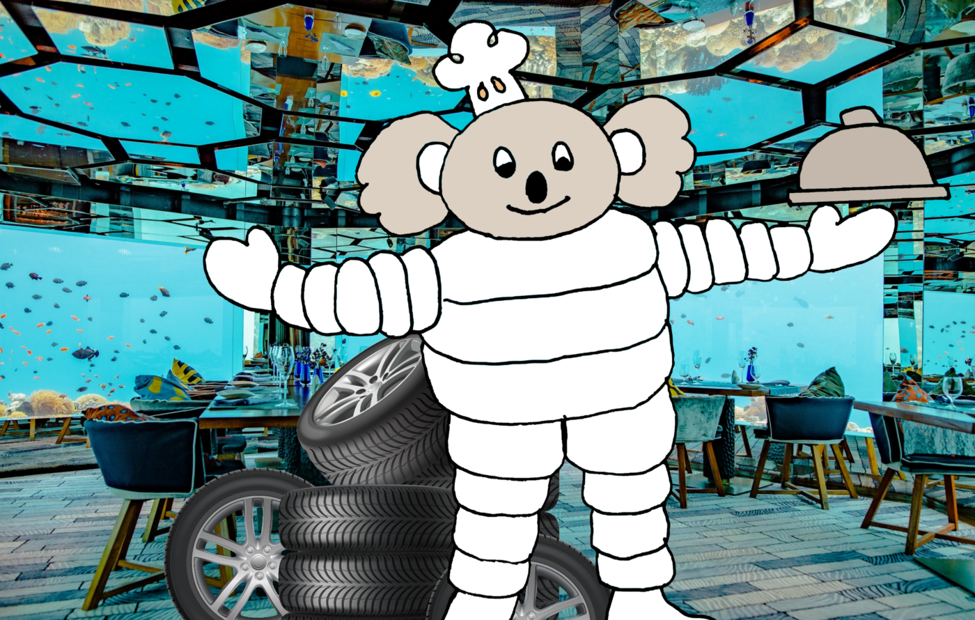 Illustration of a koala in a Michelin Man outfit holding a platter inside of a fancy restaurant. There is a pile of tires behind him.