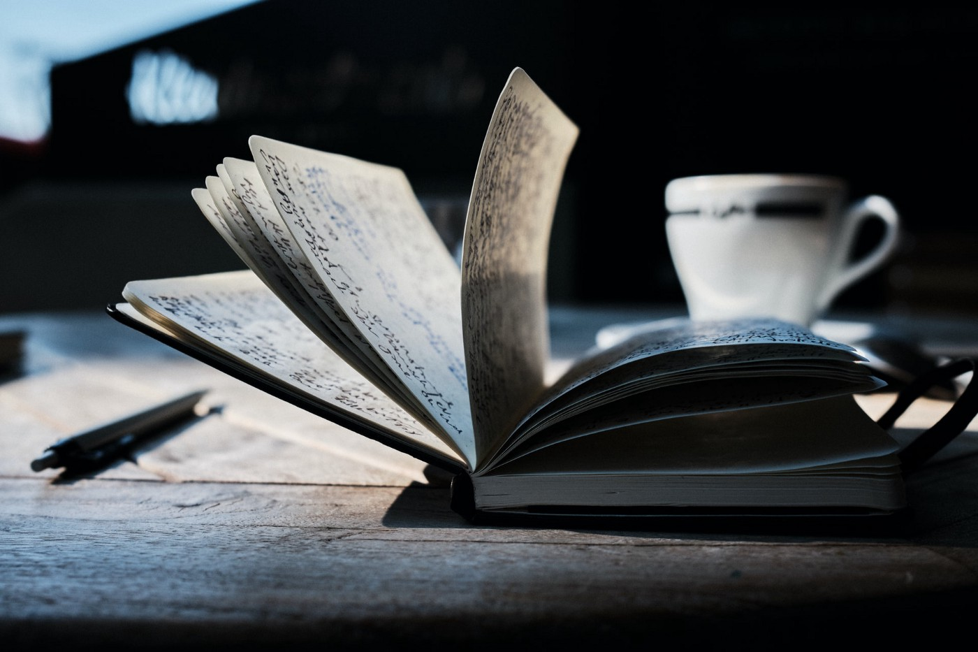A book and a mug. Photo from Unsplash by Yannick Pulver.