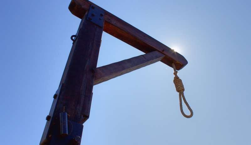 A noose hanging from the gallows