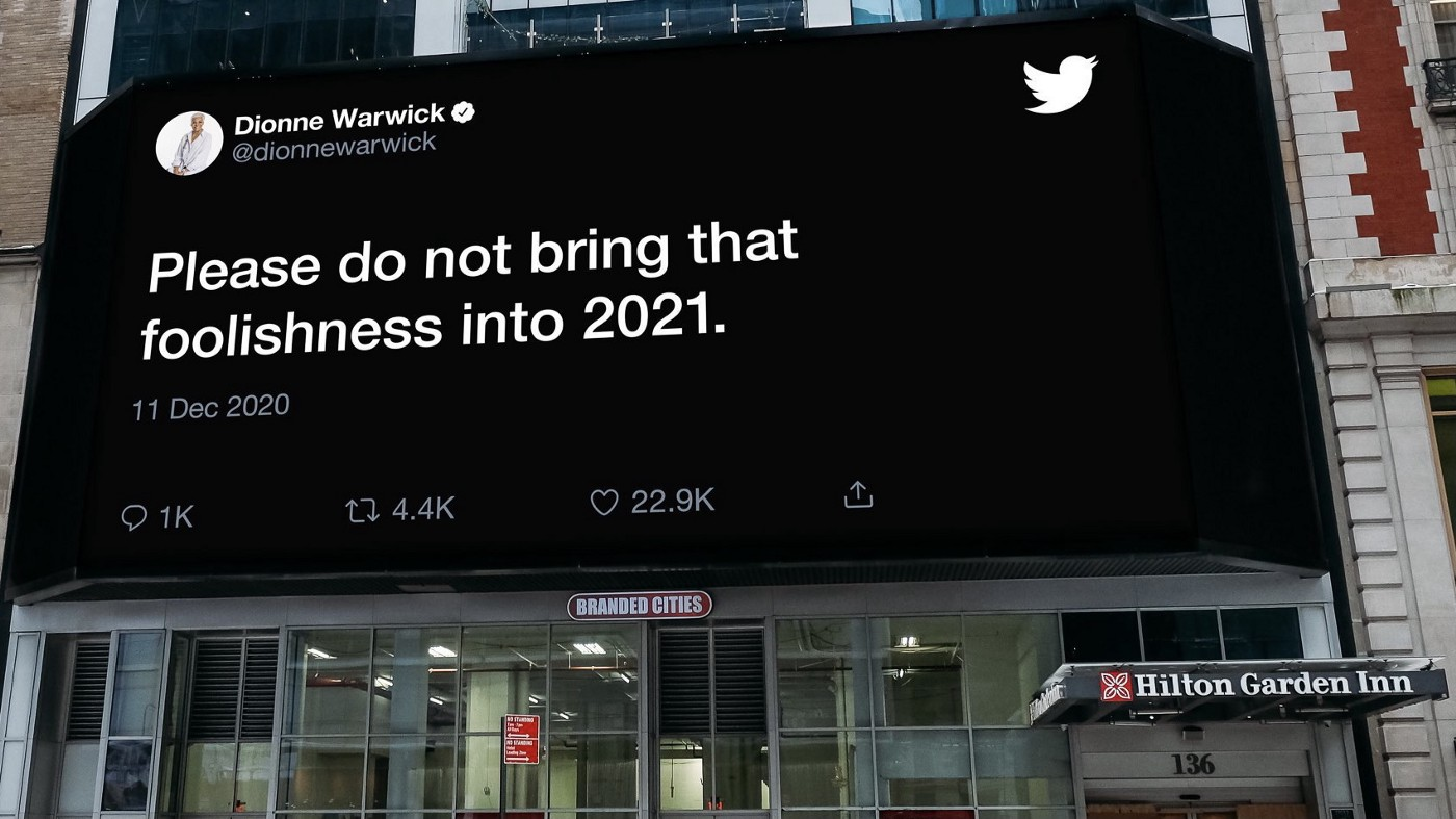 """A banner displaying a December 2020 tweet by Dionne Warwick that says """"Please do not bring that foolishness into 2021."""""""