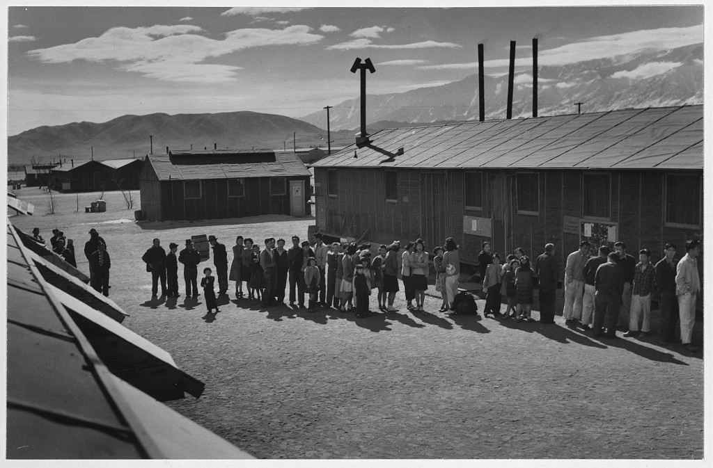 Ansel Adams photograph of the mess hall lunch line at the Manzanar Relocation Center, California.