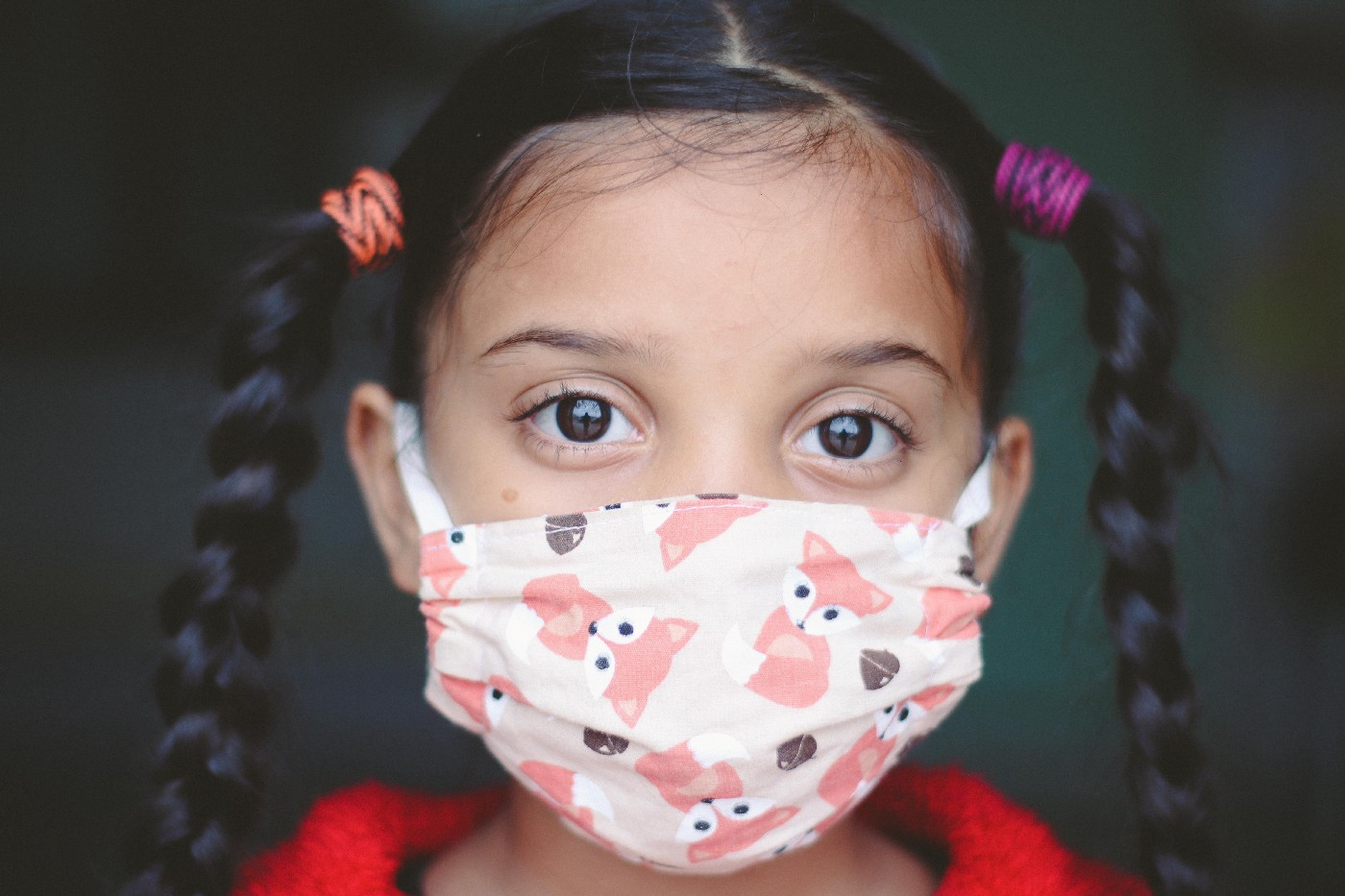 girl wearing covid-19 mask