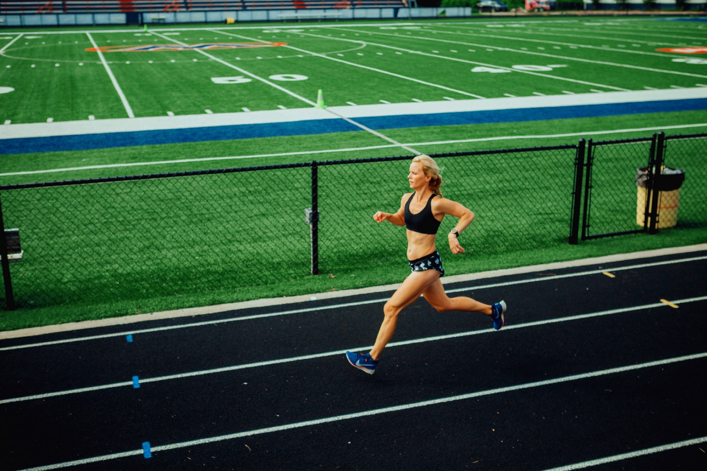 Woman running on a track.