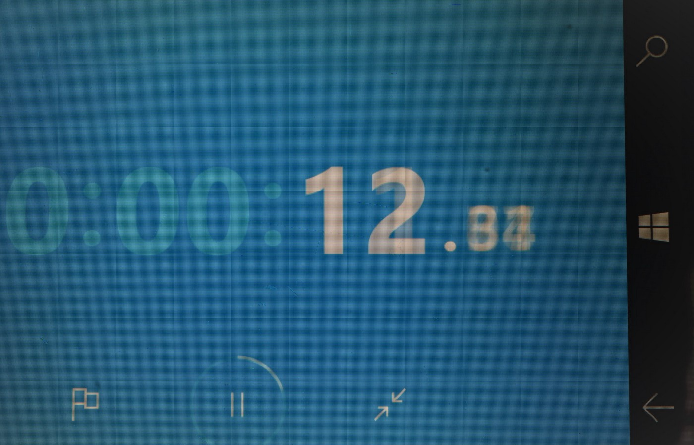 cellphone stopwatch numbers in close-up, shot at slow shutter speed to blur the digits: white digits on blue background
