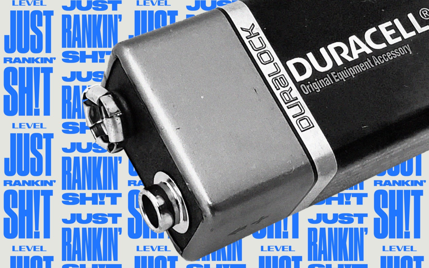 "A partial view of a Duracell D battery in black & white against a background with the repeating text ""Just Rankin' Shit."""