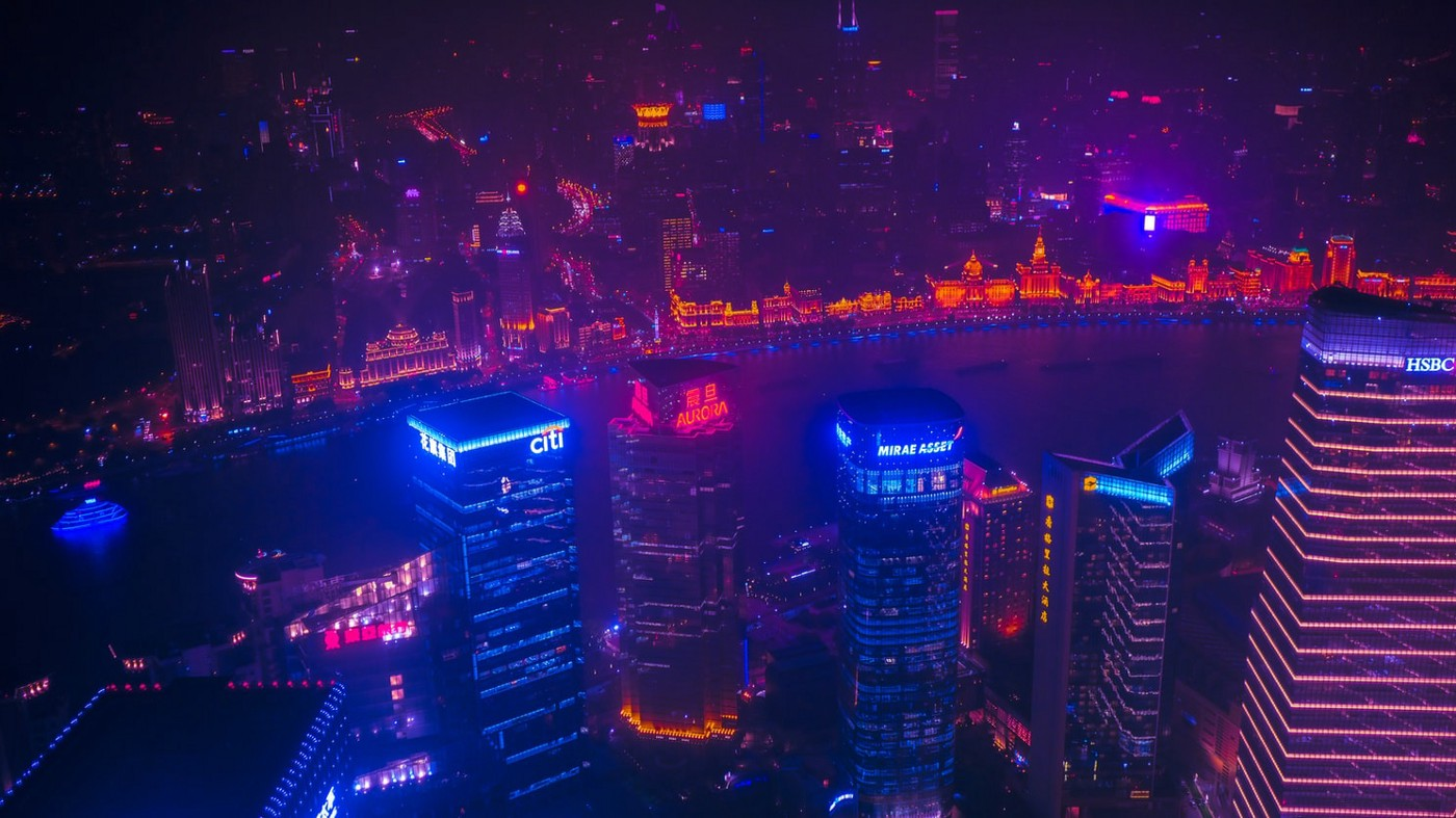 A cityscape is covered in neon blue and red lights to look futuristic.