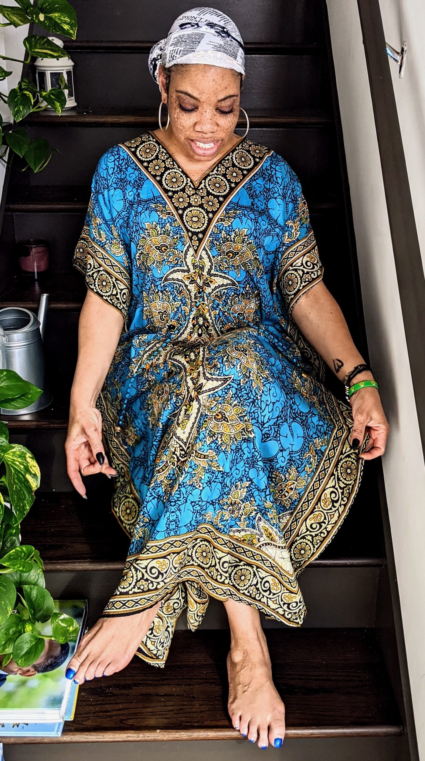 A photo of the author wearing a caftan.