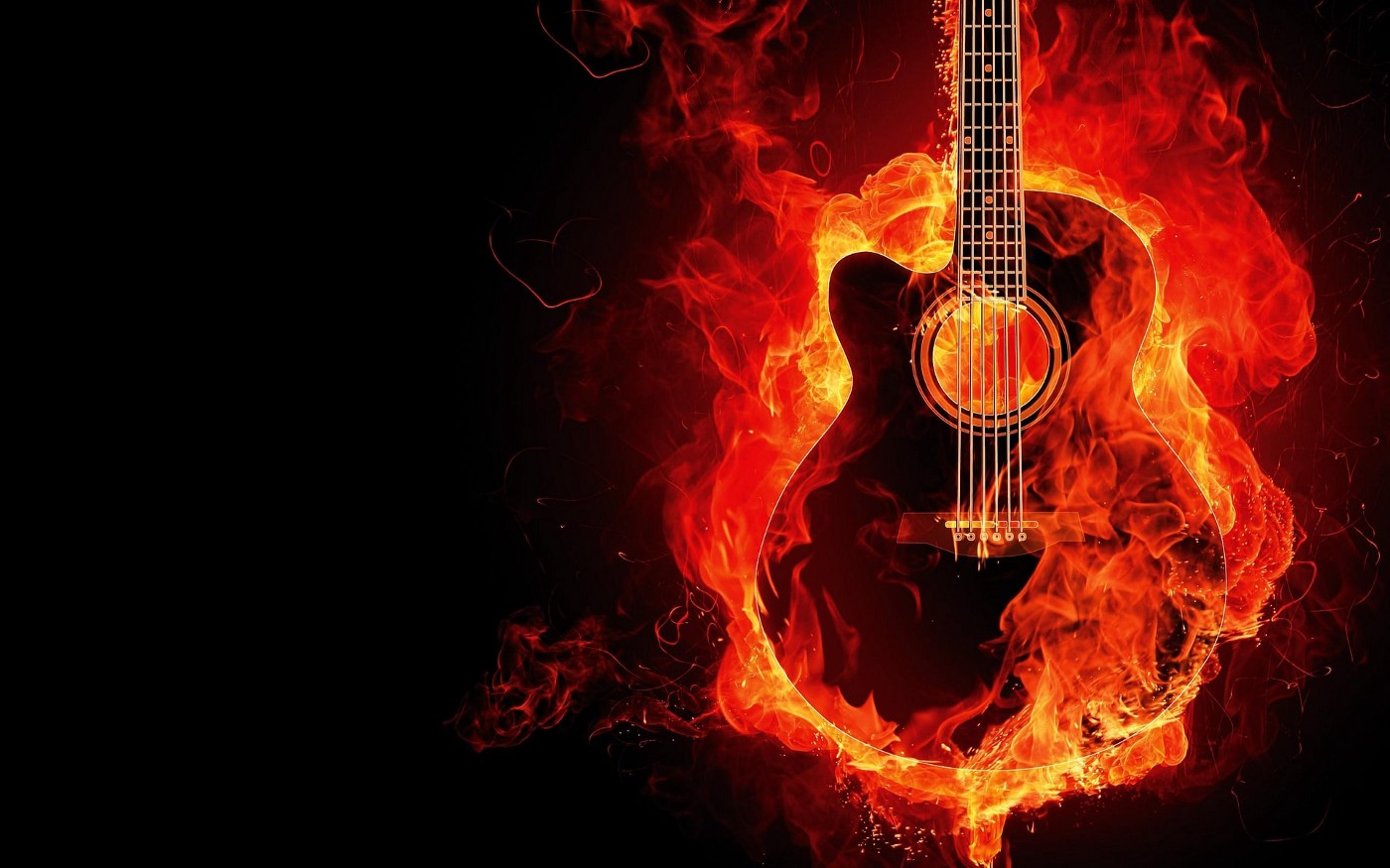Image of an Acoustic 6 string guitar set on fire and bursting into flames