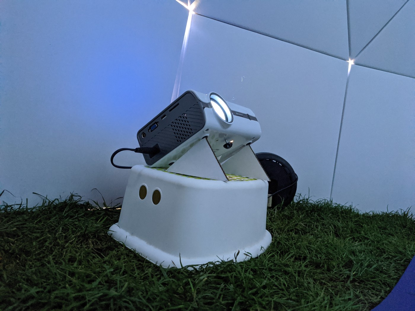 Projector propped up by cardboard