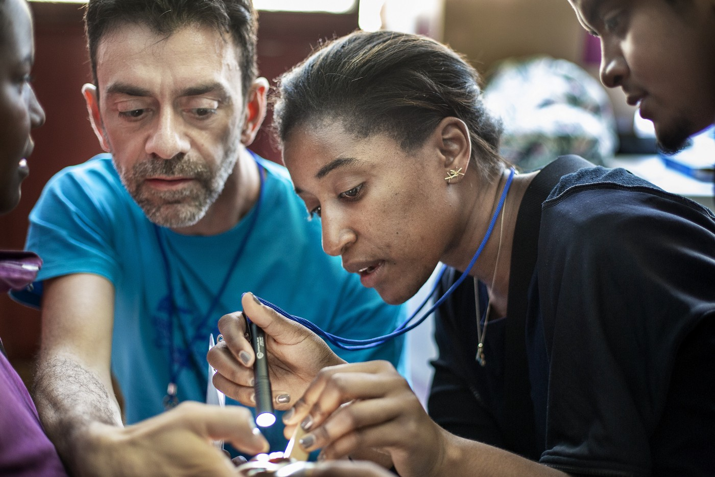 Cleft Surgeon, Fellow, Naikhoba Munabi of the US, Cleft Surgeon Luca Autelitano of Italy evaluates a patient with me during a