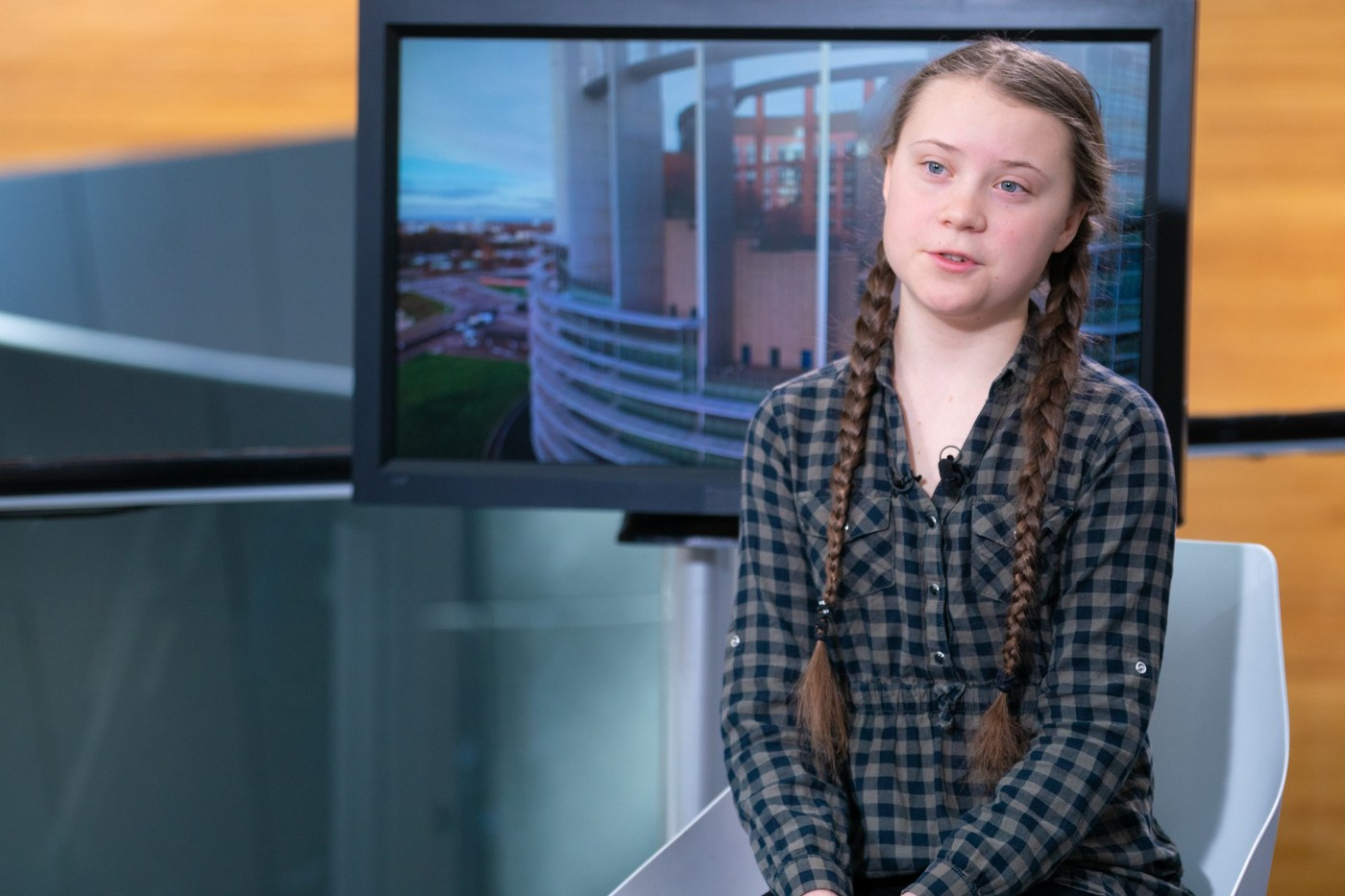 Swedish teen Greta Thunberg sits for an interview before speaking to the European Parliament