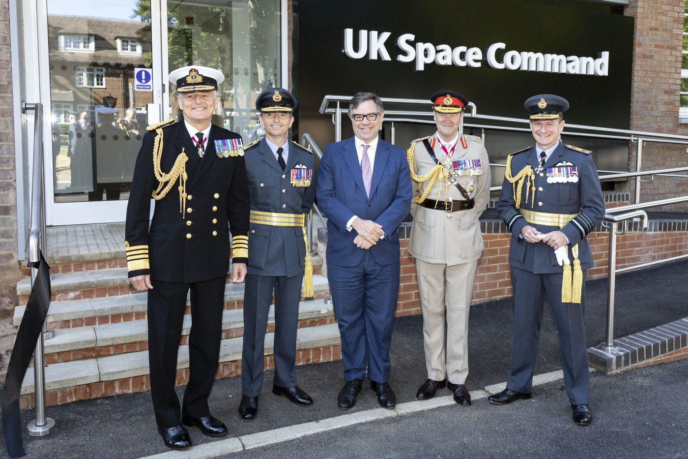 (Left to Right) Vice-Chief of the Defence Staff Admiral Sir Tim Fraser, Air Vice Marshall Paul Godfrey OBE, Minister for Defence Procurement Jeremy Quin, Commander UK Strategic Command General Sir Patrick Sanders, and Air Chief Marshal Sir Mike Wigston outside the headquarters of UK Space Command at RAF High Wycombe