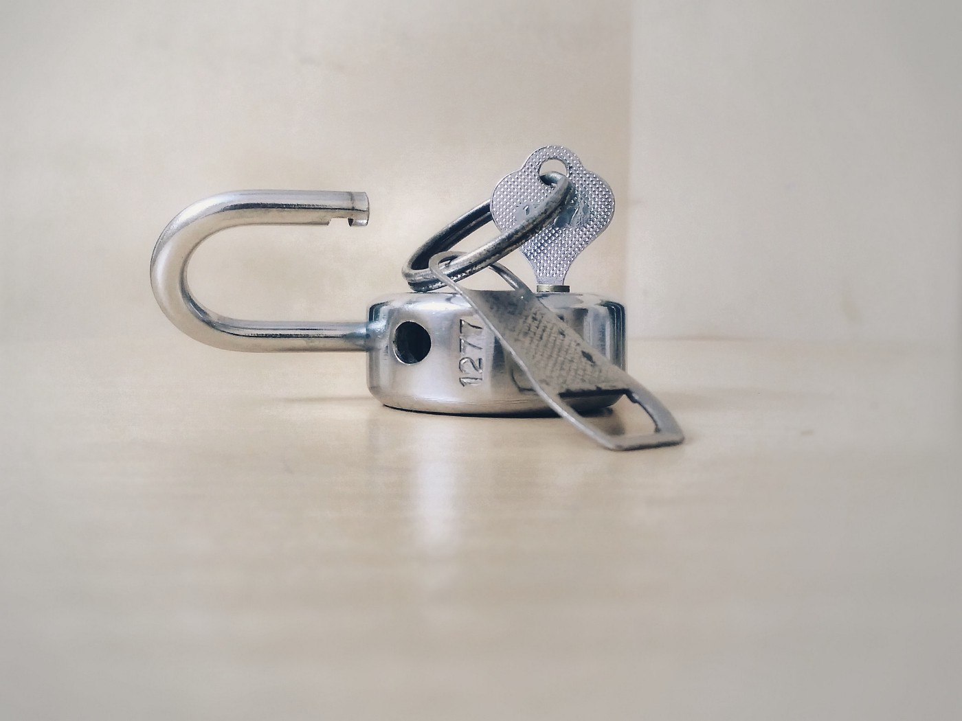 Image of a key and an open padlock.