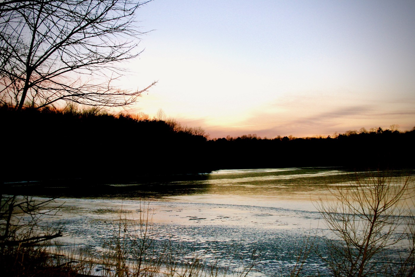 Sunset over frozen lake.
