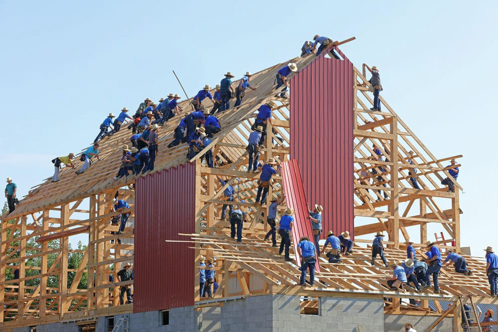 Workers building a house together