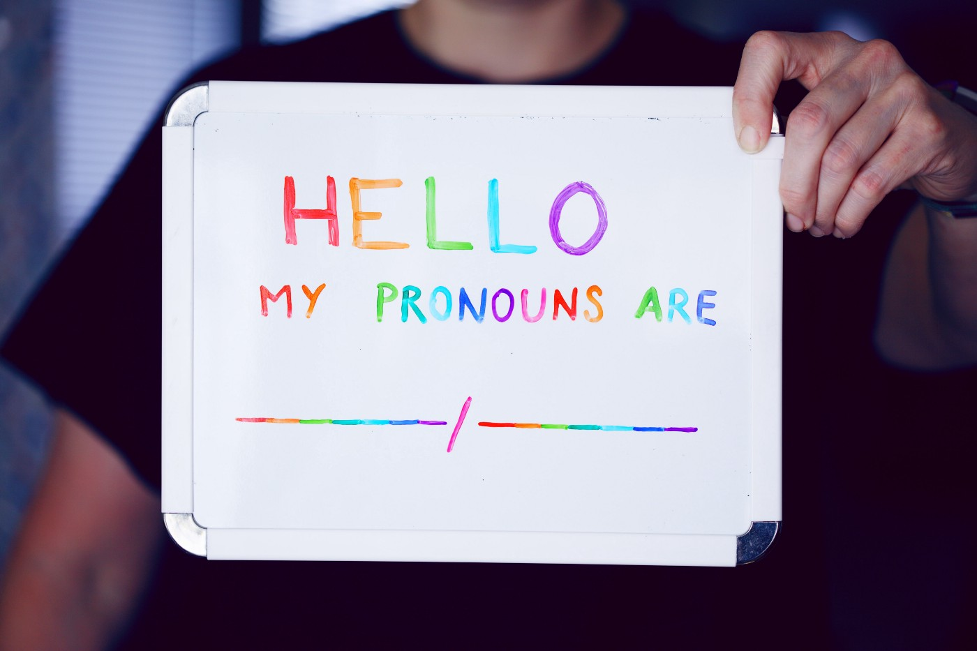 Pronoun sign with blank space written in rainbow colors