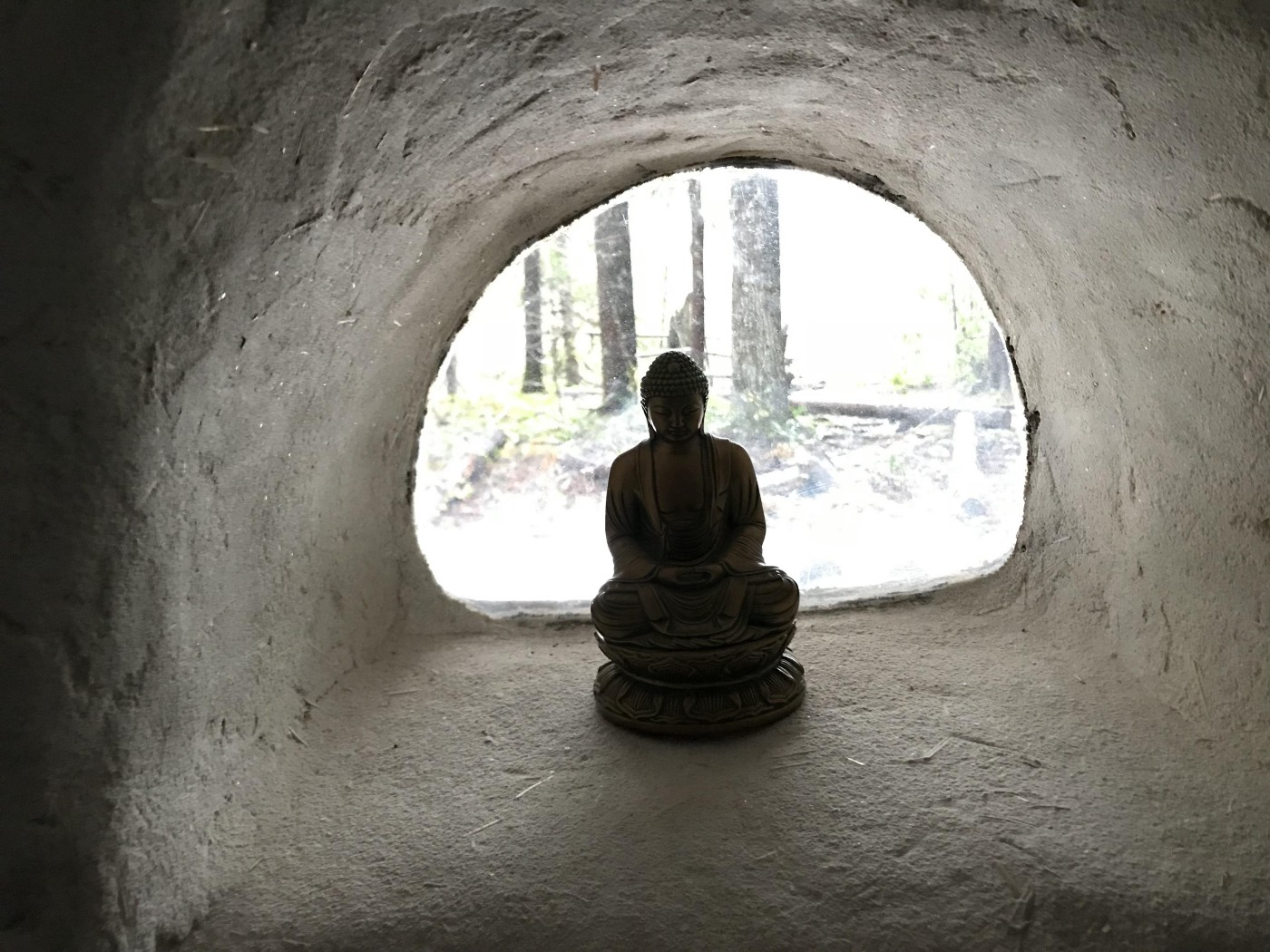 a moment of presence—meditating at the entrance to a cave