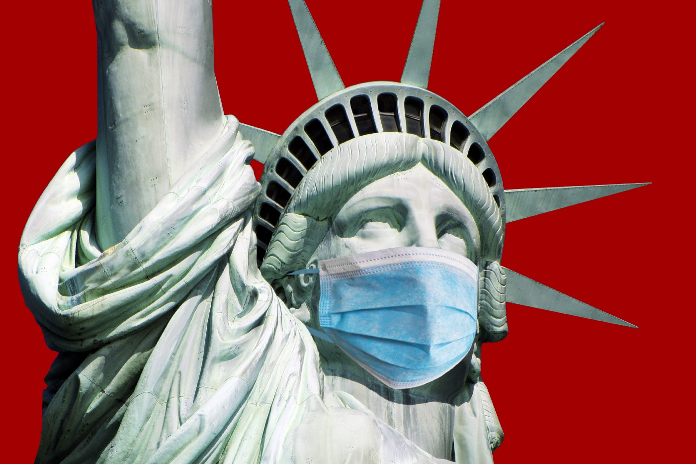 A close up of the Statue of Liberty wearing a surgical mask.