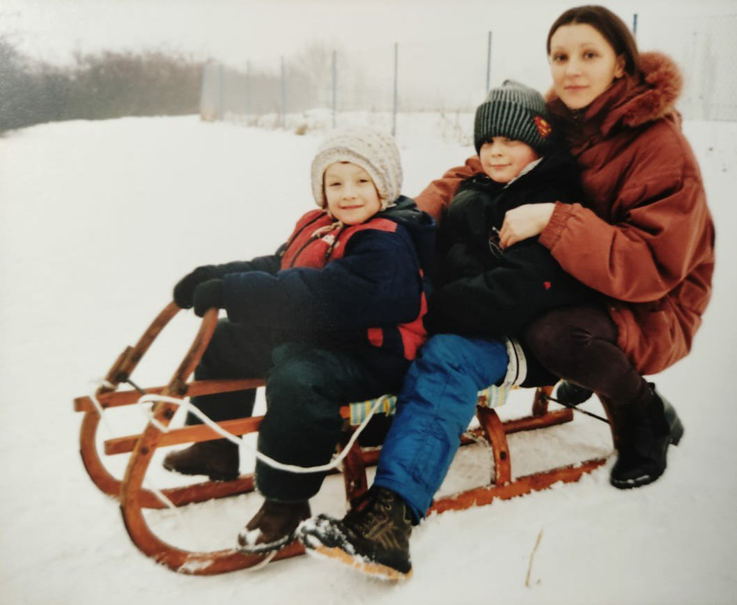 My mom, me and my brother sledding