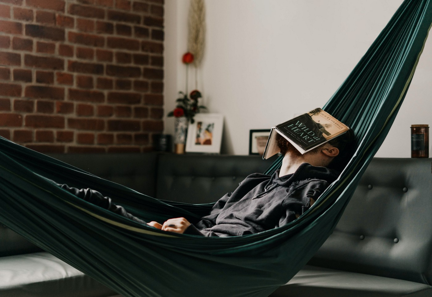 Millennial sits in hammock contemplating existential dread during 2020 quarantine