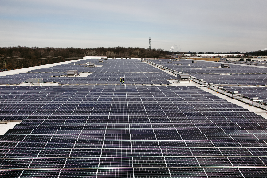 The expansive solar rooftop of an Amazon facility