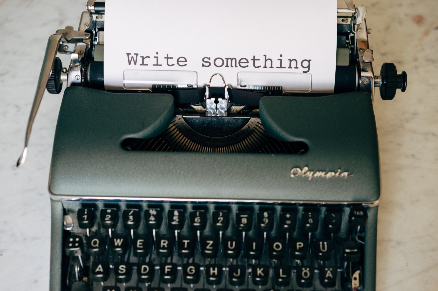 Typewriter with the words Write Something on the paper