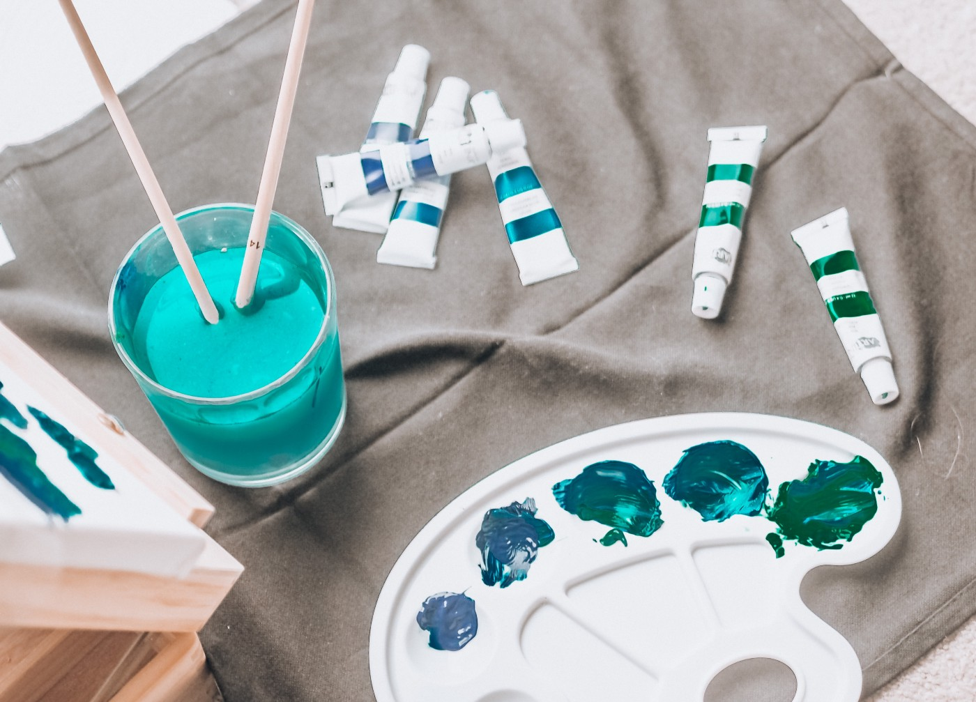 paintbrushes and a palate of paints