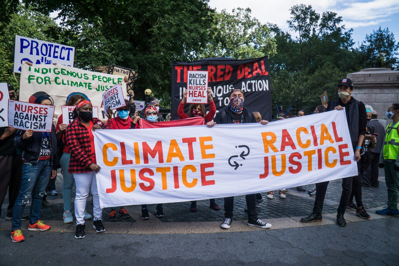 Rise and Resist activist group marched together to demand climate and racial justice.