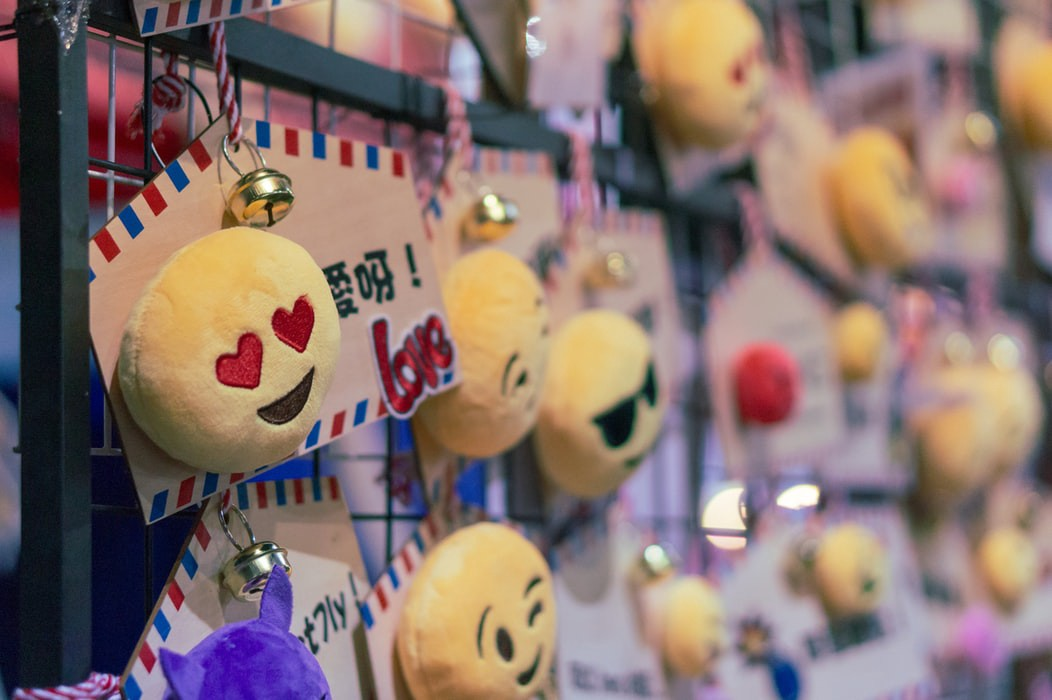 stuffed toys in the shape of emojis