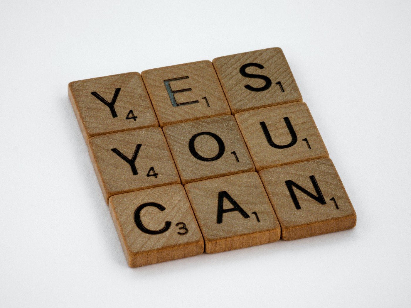 Photo of letter blocks saying YES YOU CAN