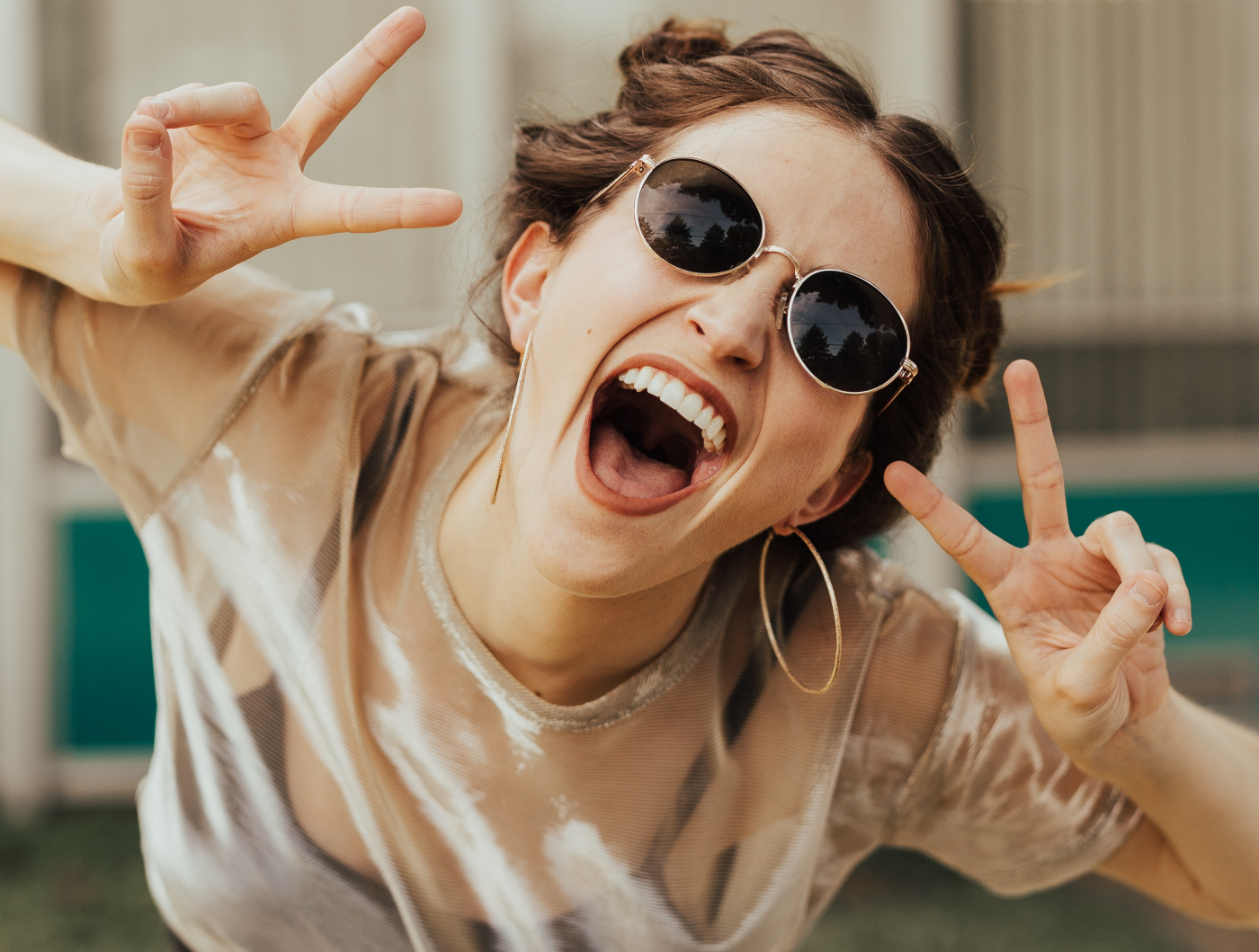 girl smiling and making peace signs