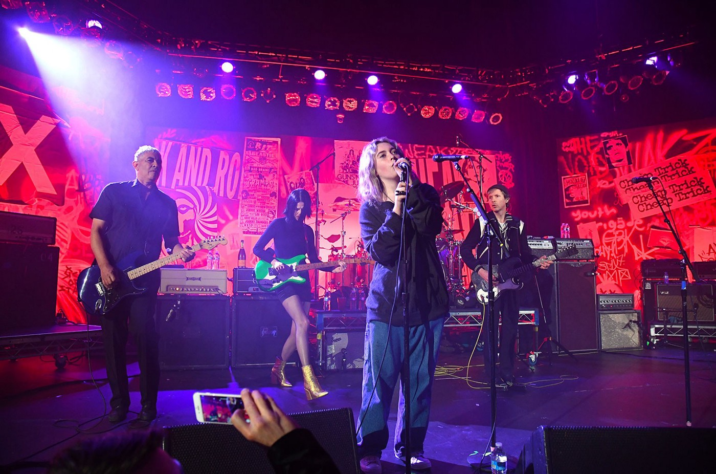 Colored photograph by Kevin Mazur/Getty Images for DG. Violet Grohl, Dave Grohl, Beck, St. Vincent, Krist Novoselic and Pat Smear perform onstage during The Art of Elysium and We are Here Present Heaven is Rock and Roll at Hollywood Palladium on Jan. 4, 2020 in Los Angeles.