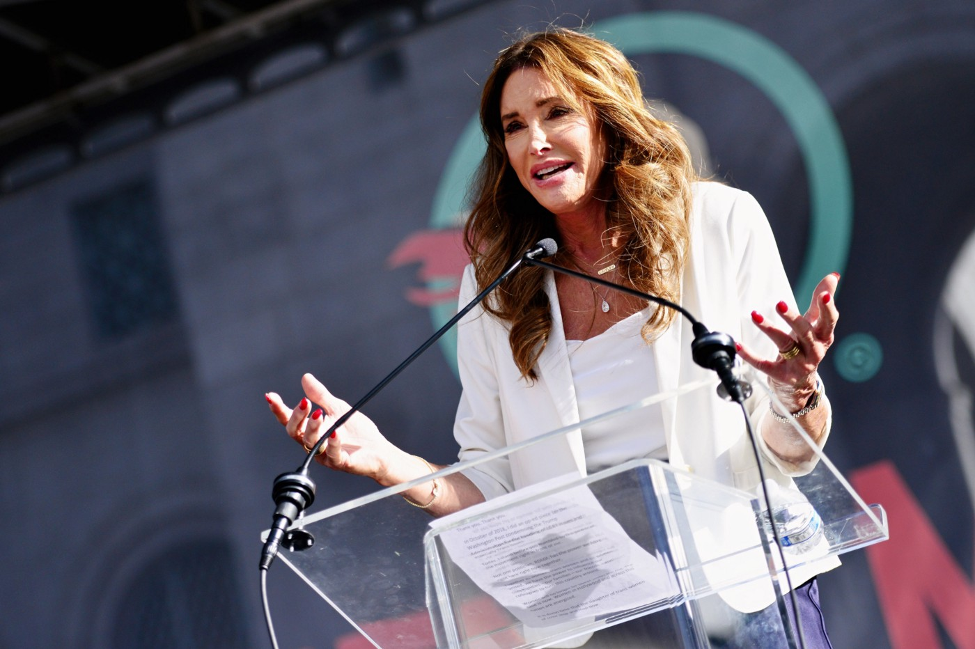 Alt-right fascist Caitlyn Jenner at the podium speaking at an event.