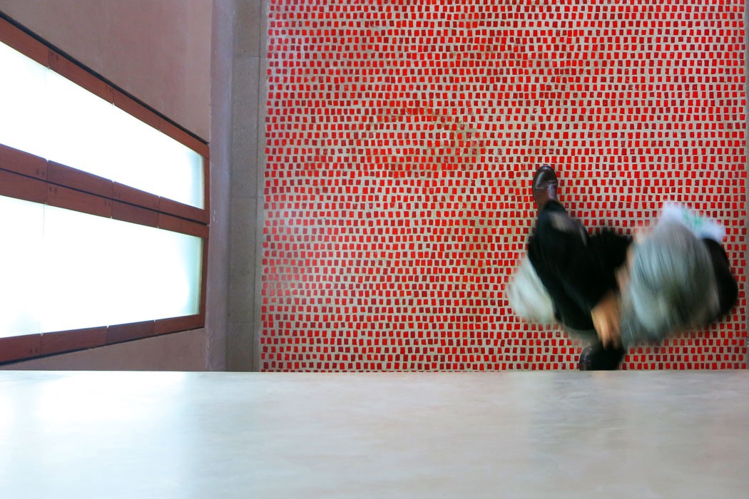 Top view of walking woman over red tiled floor