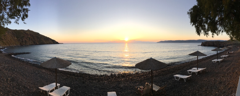 A rare, quiet moment on the Aphrodite Hotel cove beach at sunset.
