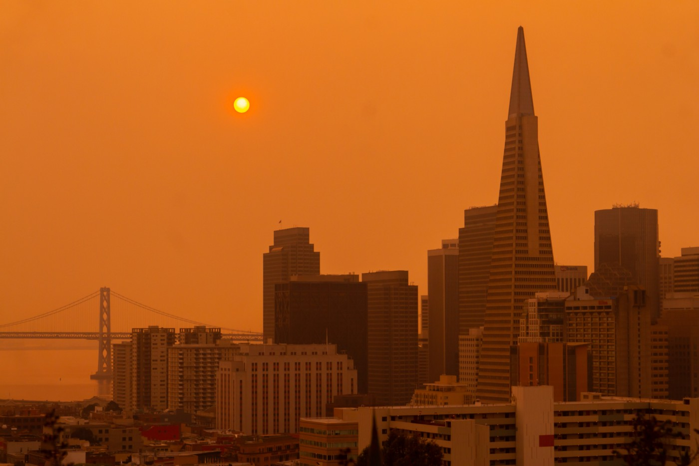 The city of San Francisco under smoke-filled skies.