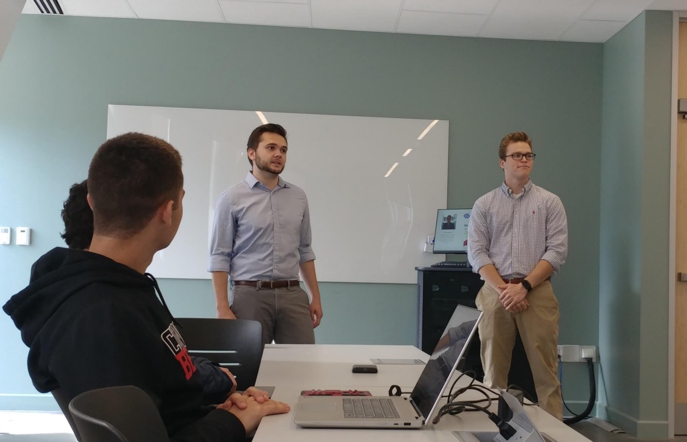 Jack Gilcrest and Ashton Barger standing in a University of Cincinnati Classroom