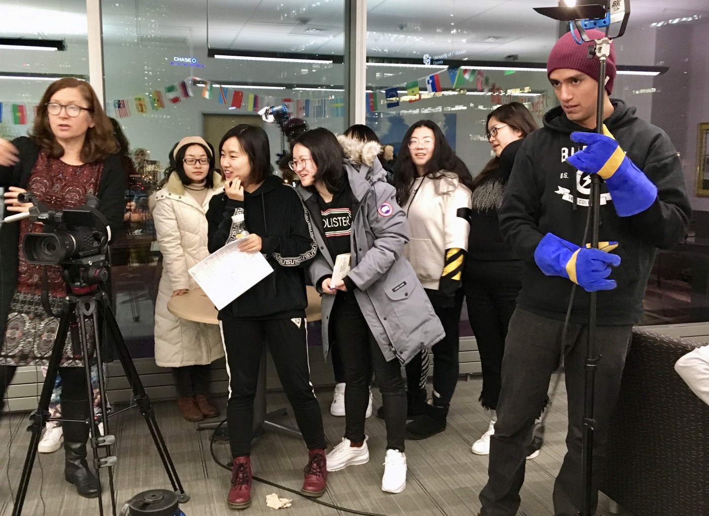 Video professional Mary Jo Brooks on the left in a classroom of University of Colorado students learning how to use professional videography equipment. The class is a diverse set of students from three different countries.