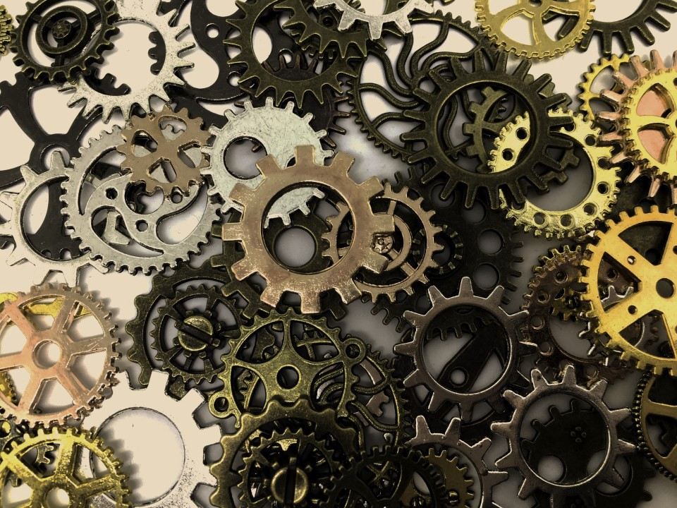 A pile of gears showing the parts of a system