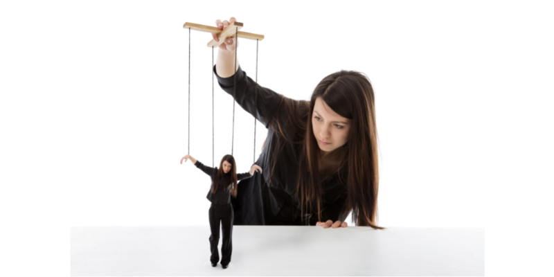 Woman controlling a puppet version of herself—5 Subtle Traits of Emotionally Exploitive Friends