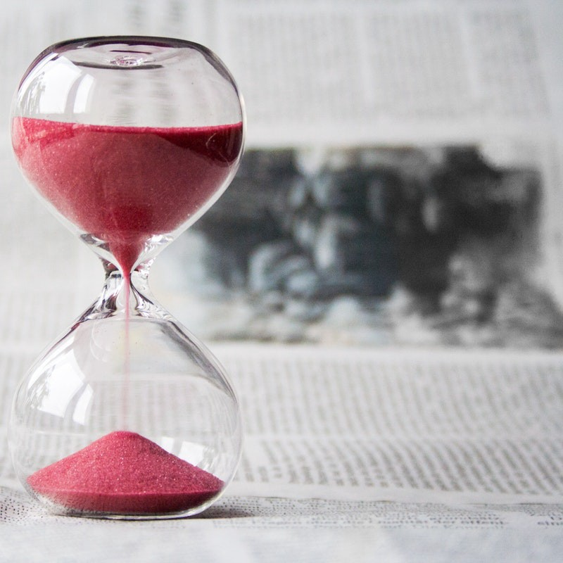 hour glass with pink sand