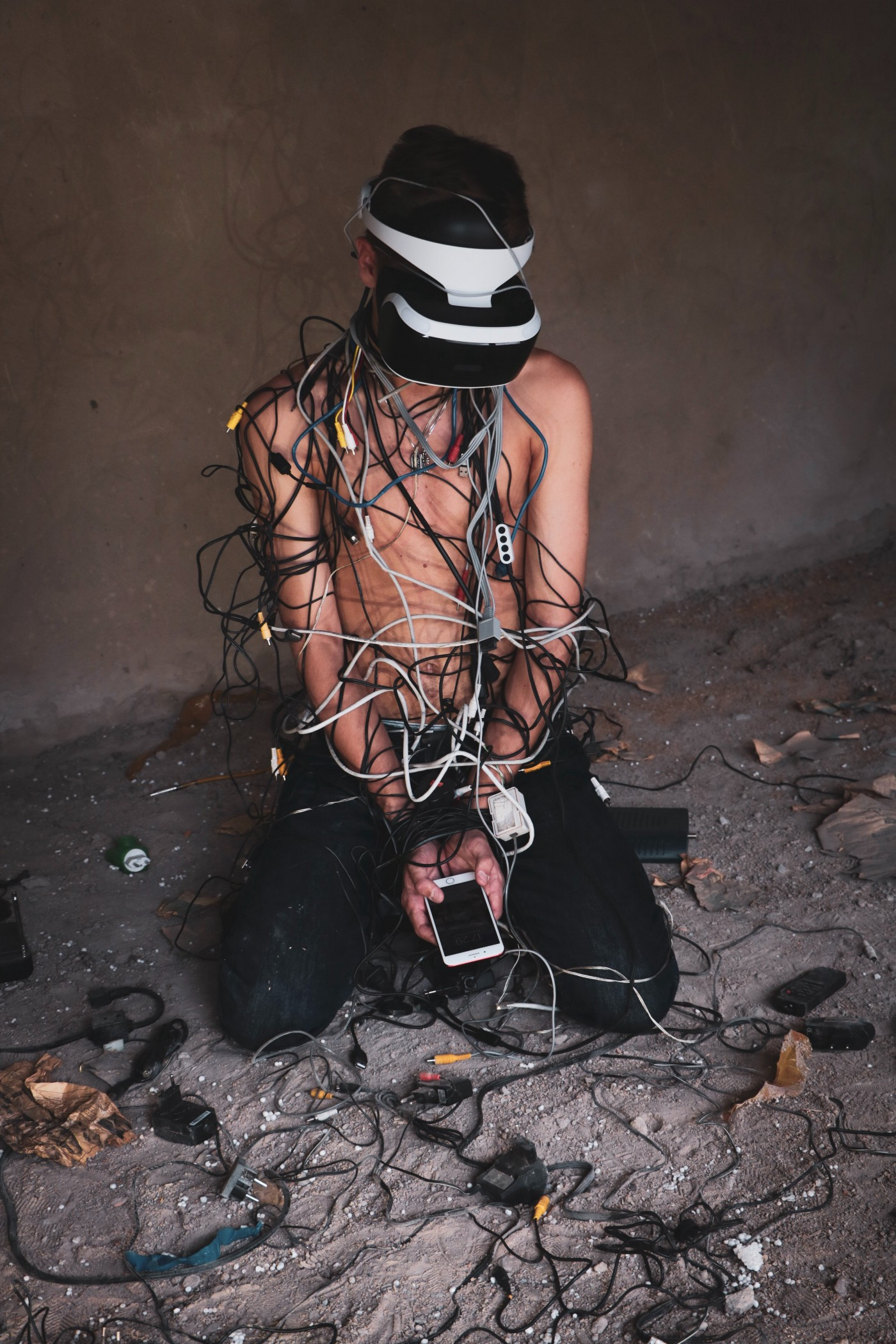 a person wearing a headset and entangled in cables
