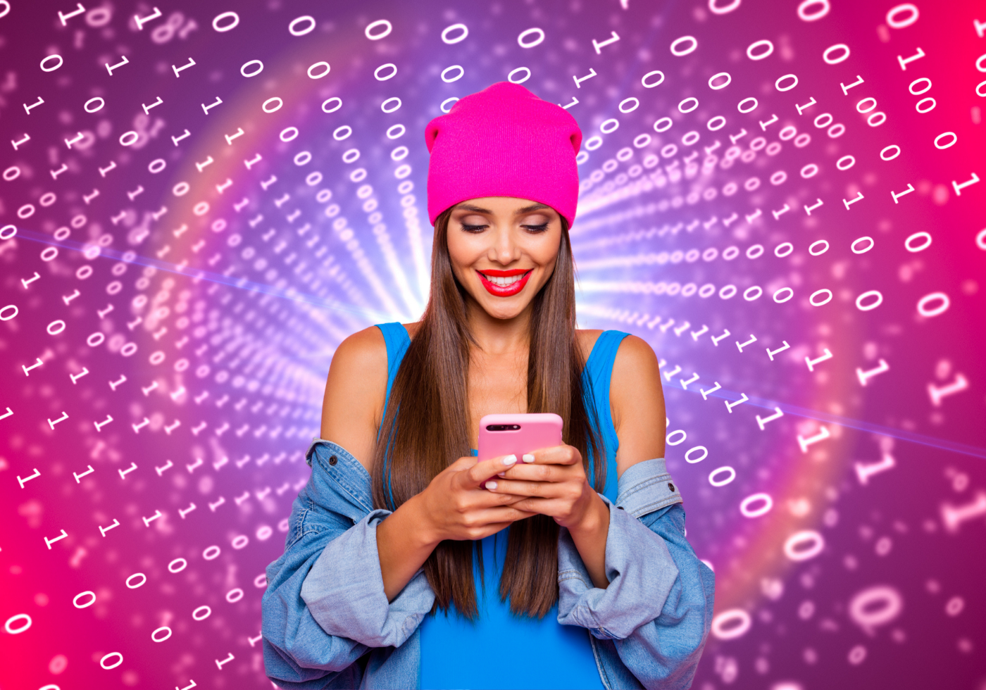 A smiling brunette with a pink beanie, a denim jacket off her shoulders and a blue tank top looks down at her phone. A purple, pink and white background of binary (1s and 0s) radiates from her.