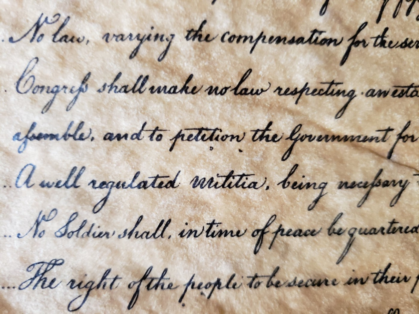 Closeup photo of scripted text of the Bill of Rights
